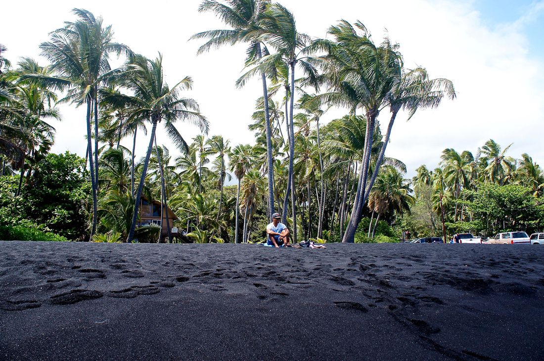 Black sand gets hotter a lot faster than typical sand. We had to wear our sandals when walking this beach.