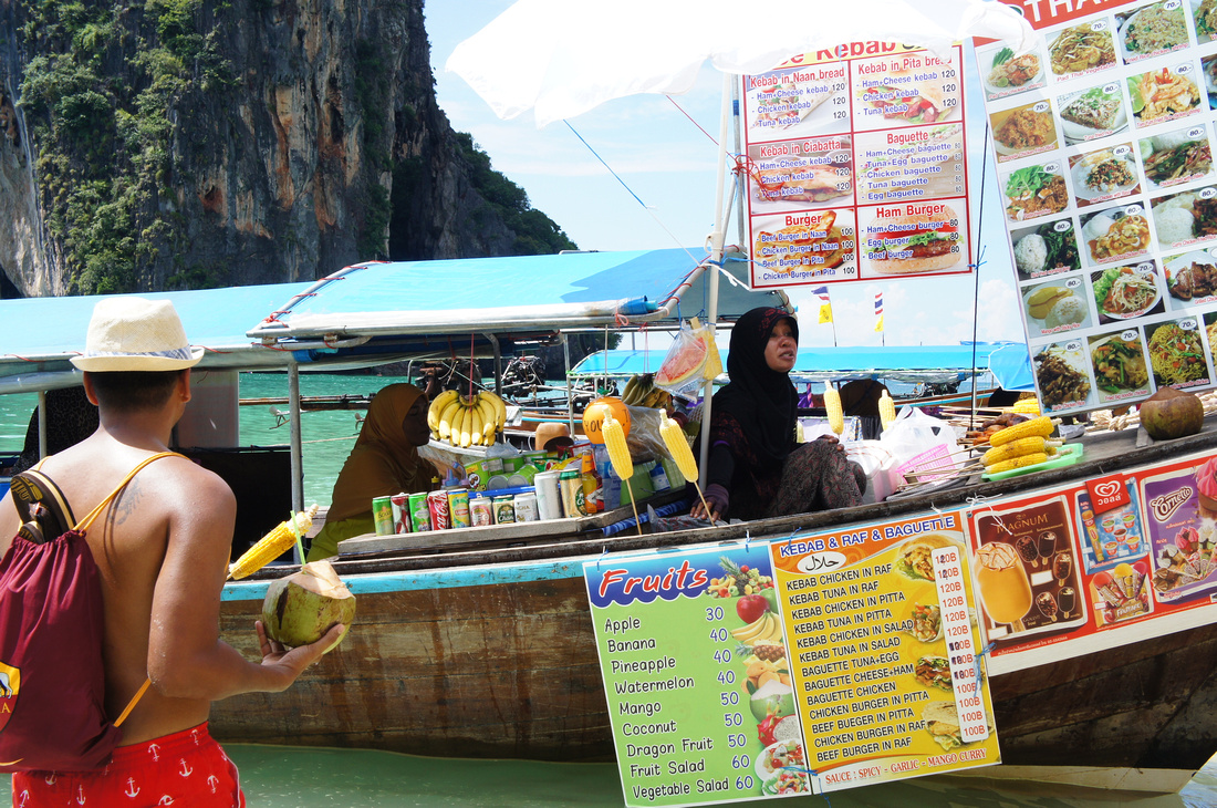 These ladies had everything on those boats and they were able to cook a variety of meals. We ordered pad-thai and some curry, followed by more pad-thai and curry. And then some mango sticky rice & fresh coconut for dessert.