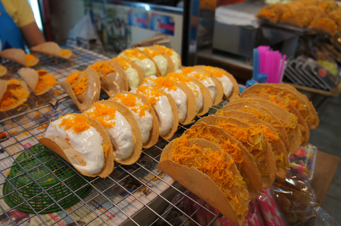 When traveling we always try to taste things we have never seen before such as these delicious thai tacos called Khanom Bueang, found in a mall in Bangkok.