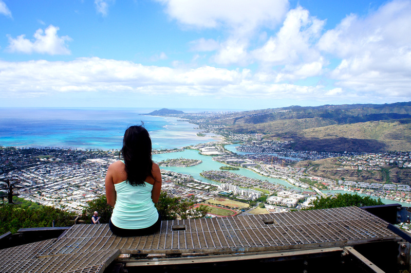 long hair female looking at Oahu from a summit