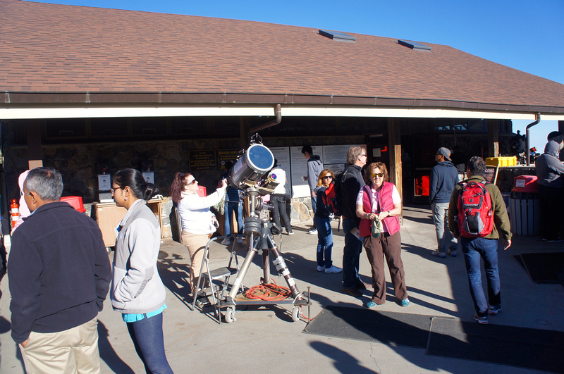 Volunteers setting up telescopes for visitors to enjoy at night.
