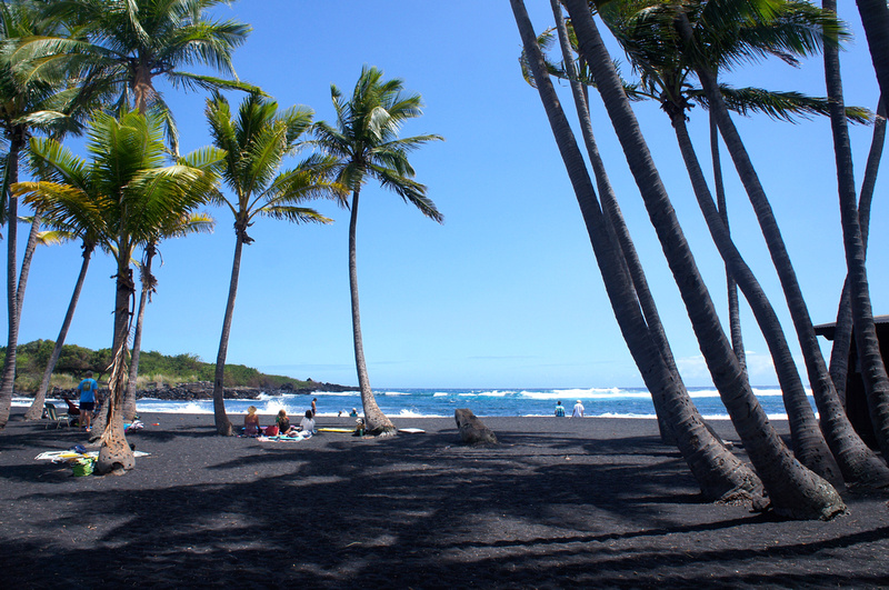 There are not many places in the world where people have the pleasure of sunbathing on a black volcanic sand beach such Punalu'u Beach. Hawaii never seizes to amaze us.